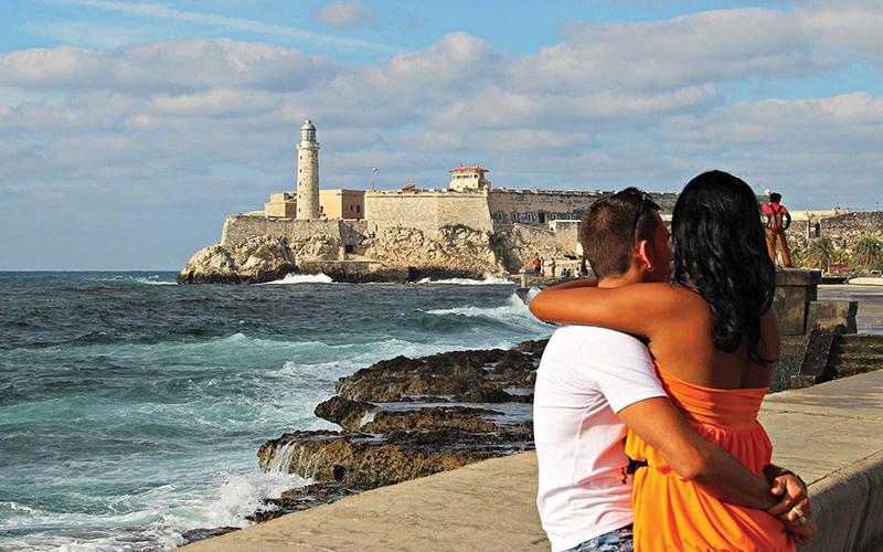 Couple Embracing near Seawall in Havana, Cuba