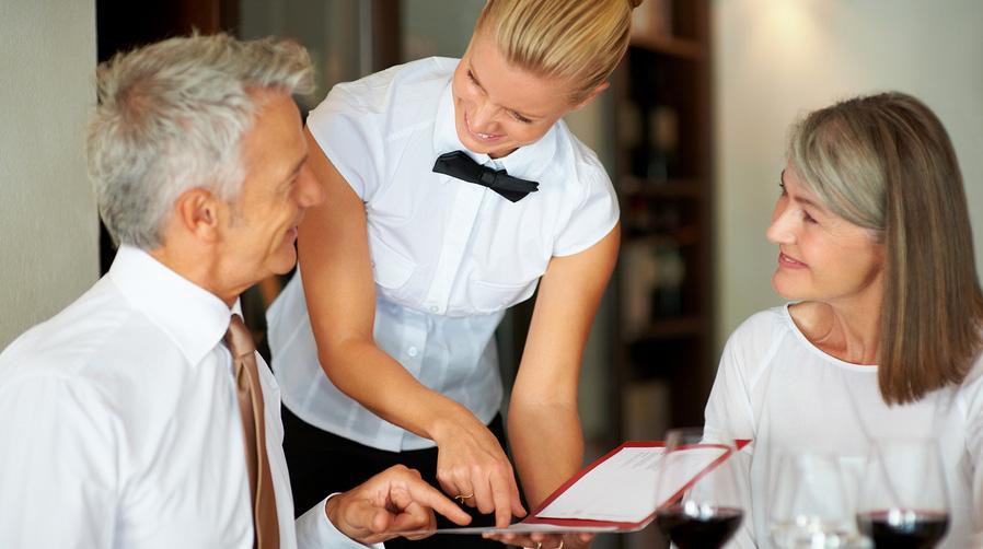 bigstock-Young-smiling-waitress-helping-22717811 (1)