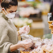 Woman in a respirator in a supermarket